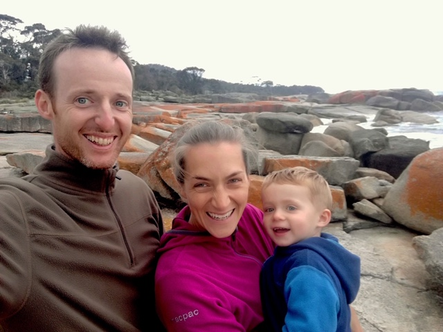 Jana, Michal and little toddler Tom on the beach smiling in Australia